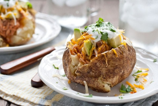 These Chicken Enchilada Loaded Baked Potatoes are an easy dinner that's a hit with kids and adults!
