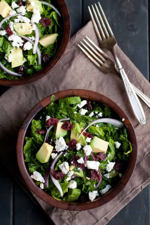 Massaged Kale Cranberry and Avocado Salad is a healthy filling recipe for any time of year.