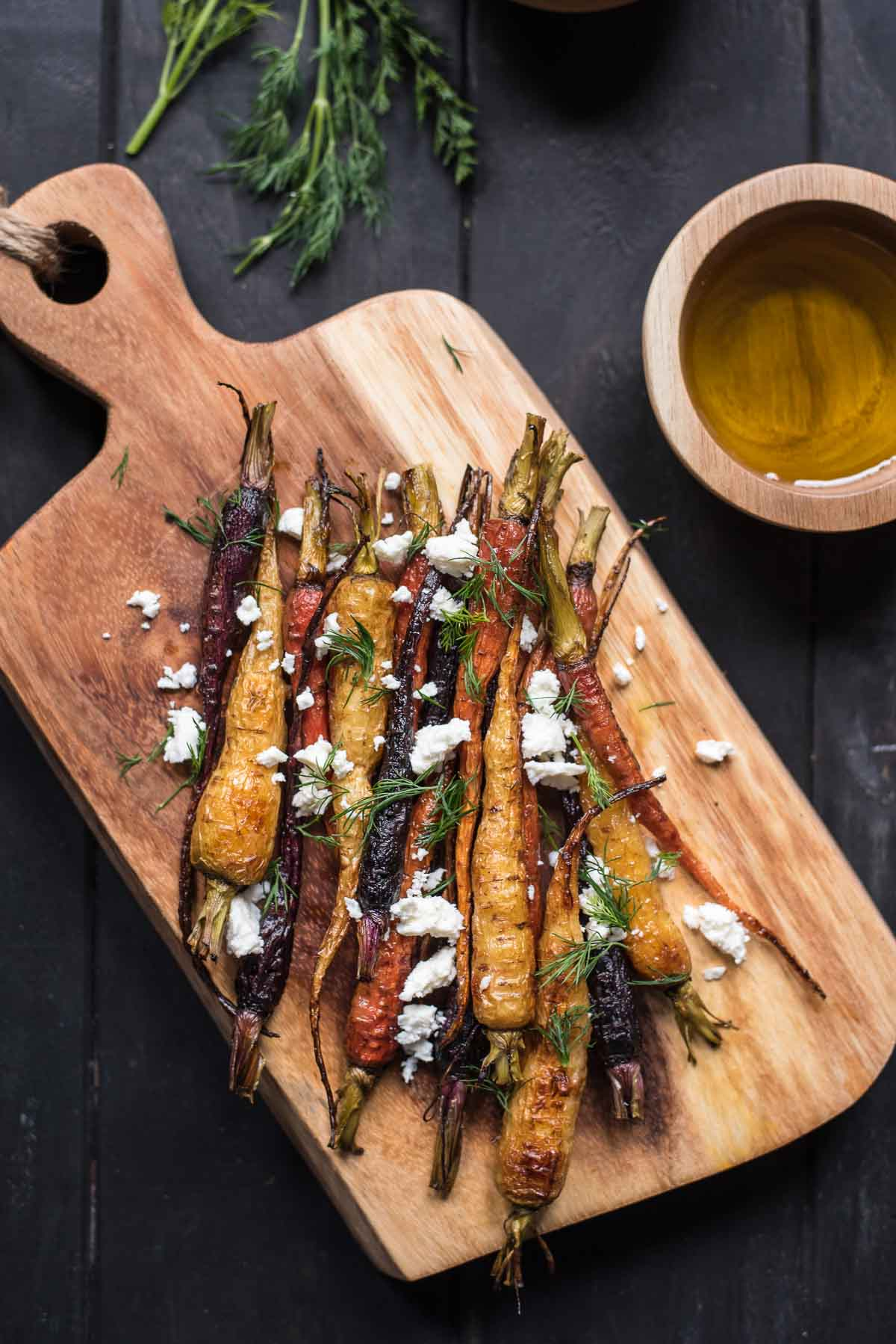 This Roasted Carrot Salad is served warm with a simple vinaigrette, feta, and dill. It's an easy side dish for any meal.