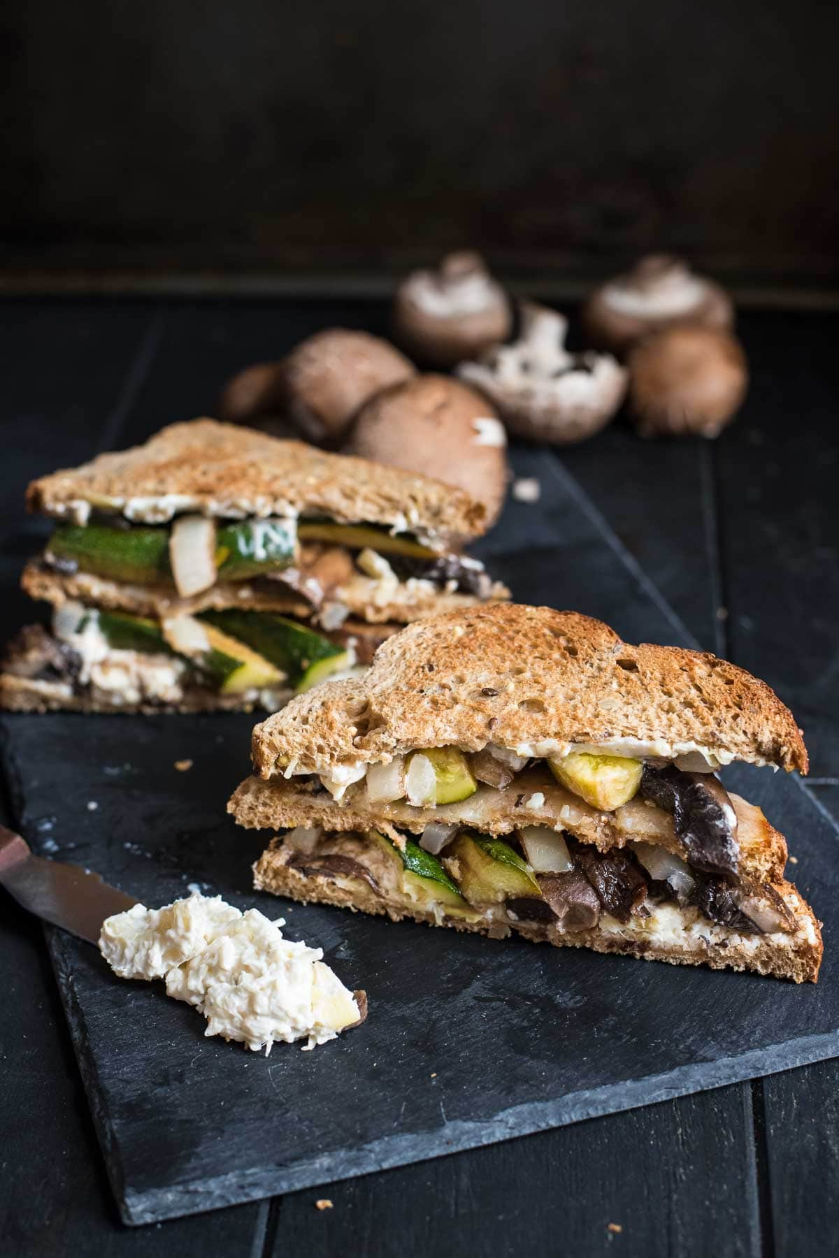 This Veggie Sandwich is loaded with roasted portabello mushrooms, zucchini, onions, and a creamy spread!