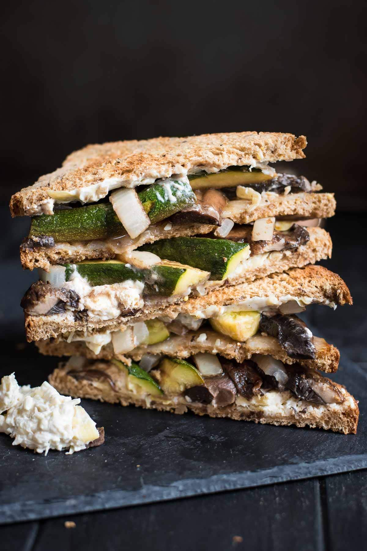 This is no ordinary veggie sandwich recipe! Loaded with roasted portabello mushrooms, zucchini, onion, and a creamy spread, this sandwich will satisfy the heartiest of appetites!