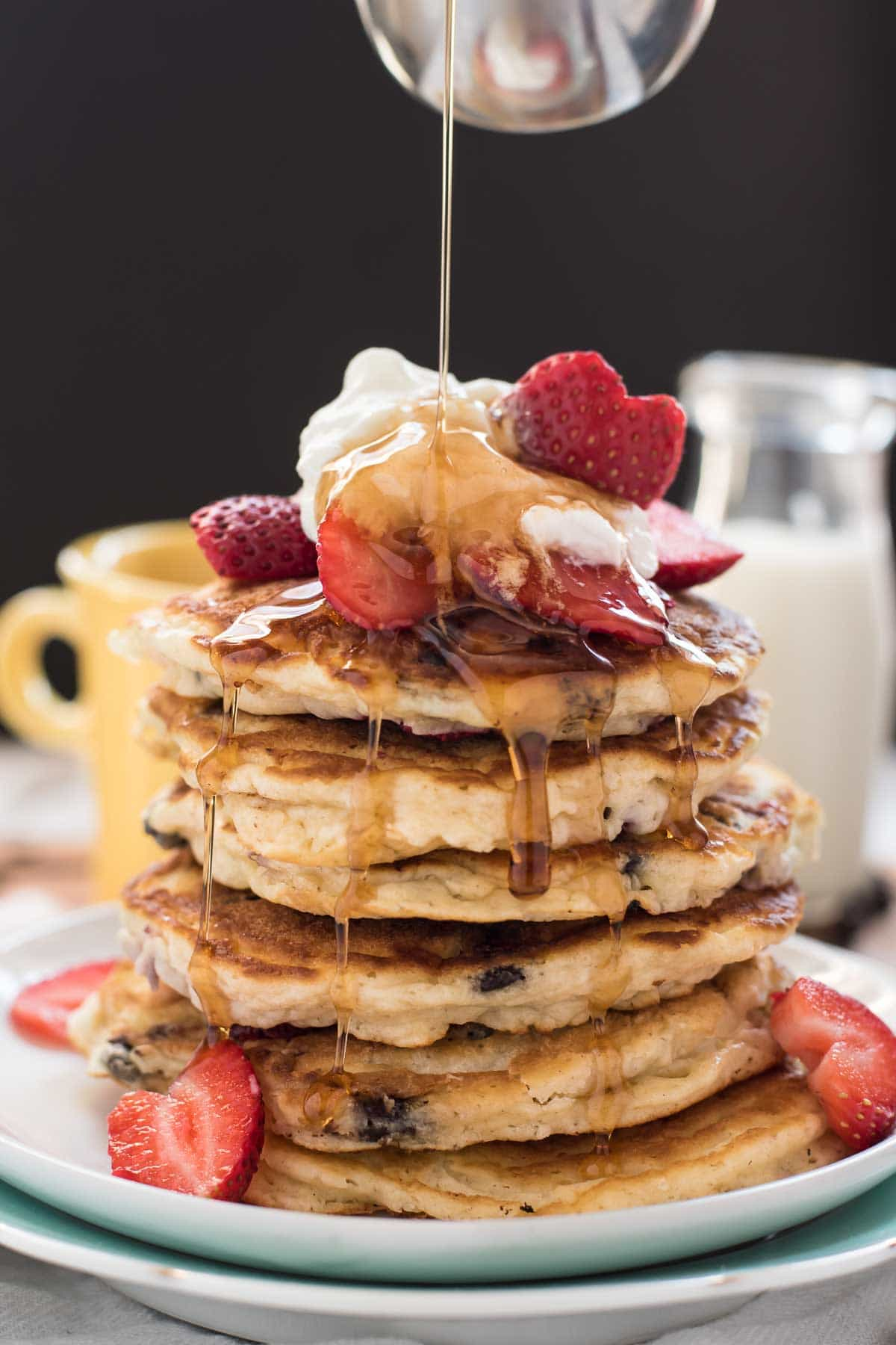 This stack of Strawberry Chocolate Chip Pancakes is the perfect breakfast for Valentine's Day.