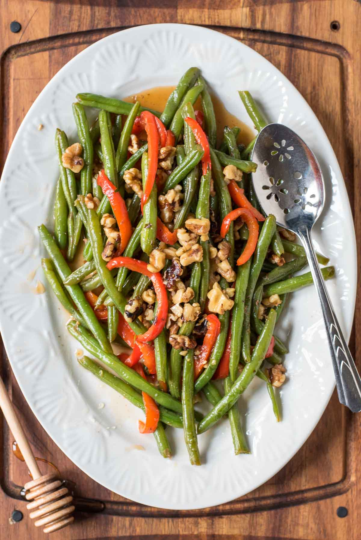 These Honey Green Beans with Red Pepper and Walnuts can be sauteed in 10 minutes flat! They're such an easy and beautiful side dish for busy weeknights or holidays.