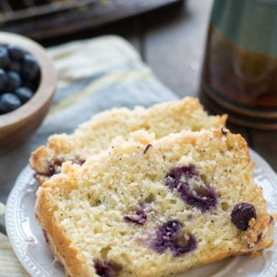 This Lemon Blueberry Bread is tangy and sweet with a perfect crumb topping and lemon glaze.