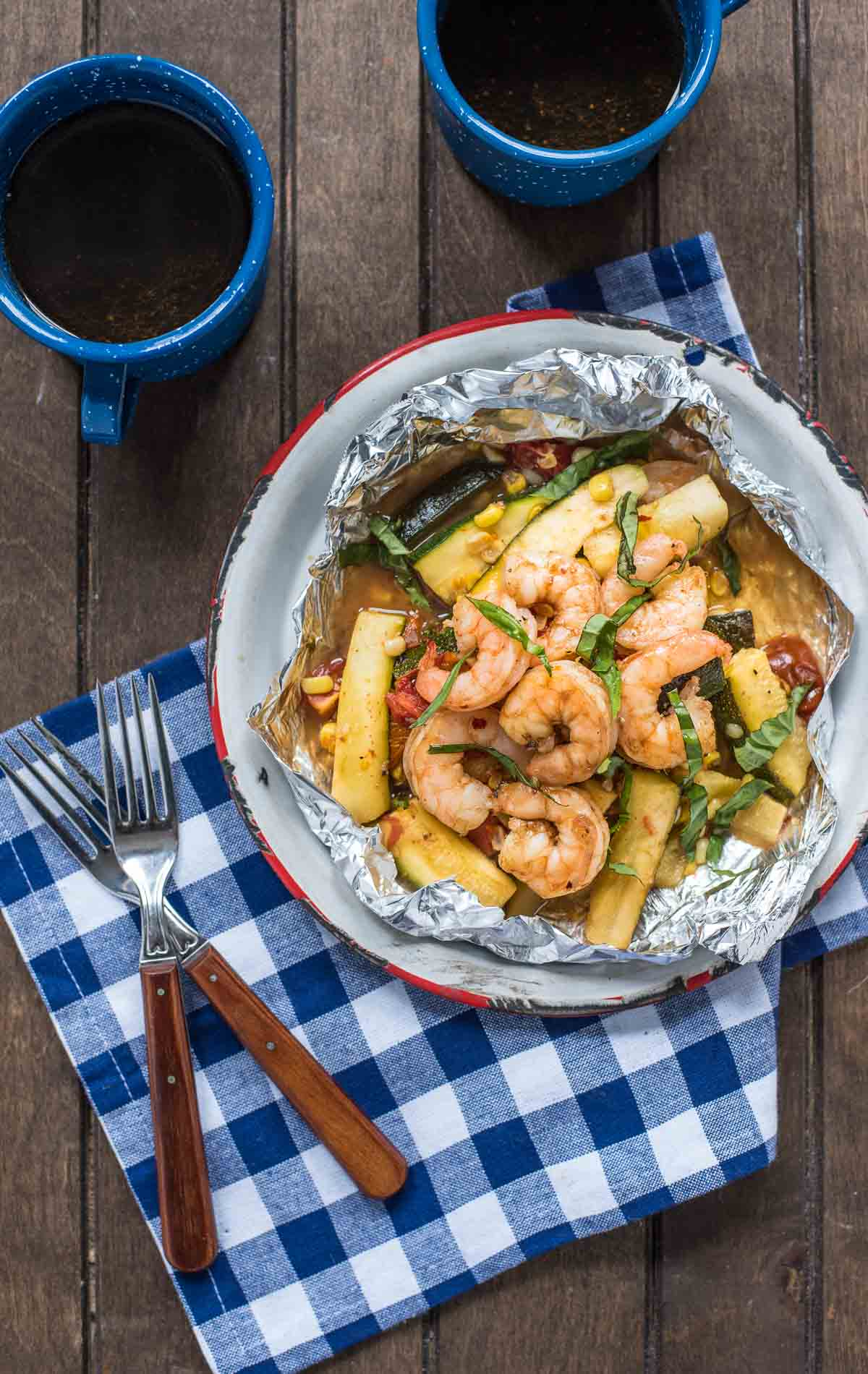 Shrimp, zucchini, tomatoes, and corn combine in a sticky tangy honey glaze in these easy Shrimp Foil Packets!