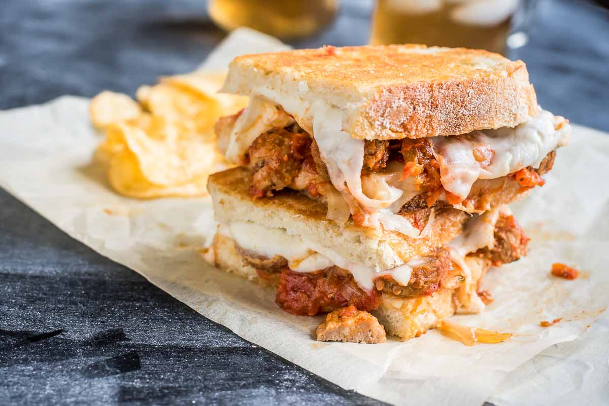 This Grilled Cheese Sandwich is loaded with saucy meatballs, smoked provolone, and mozzarella.