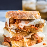Meatball subs get the grilled cheese treatment in these monster sandwiches loaded with mozzarella, provolone, onions, and saucy meatballs.