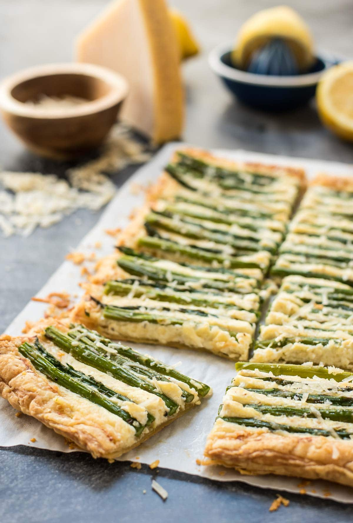 This Parmesan Asparagus Tart is the perfect appetizer for a spring brunch.