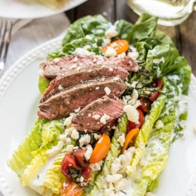 This gorgeous Steak and Blue Cheese Salad is loaded with bruschetta cherry tomatoes, homemade buttermilk dressing, blue cheese crumbles, and ribeye steak!