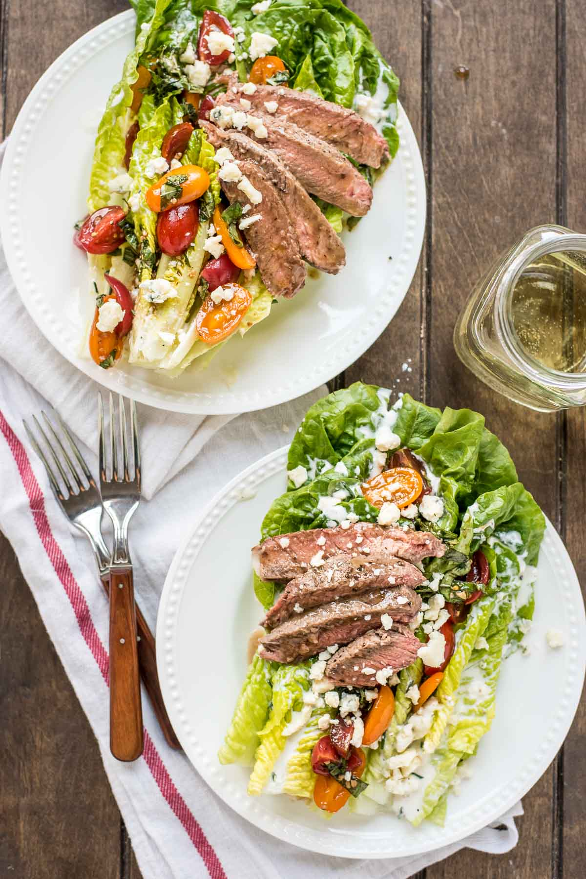 This salad loaded with bruschetta, homemade blue cheese dressing, and juicy steak is the perfect summer salad.