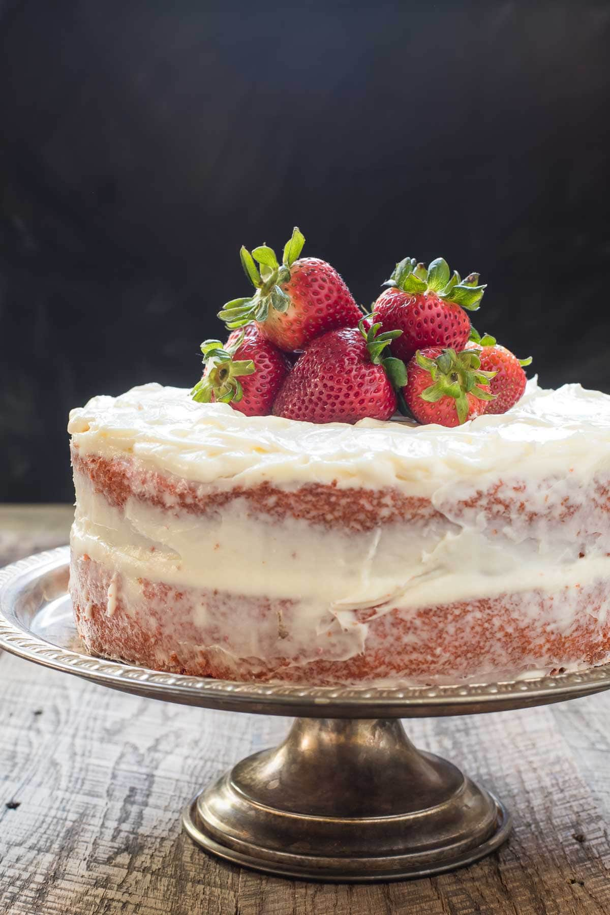 This Easy Strawberry Layer Cake Recipe is one of our favorite summer desserts!