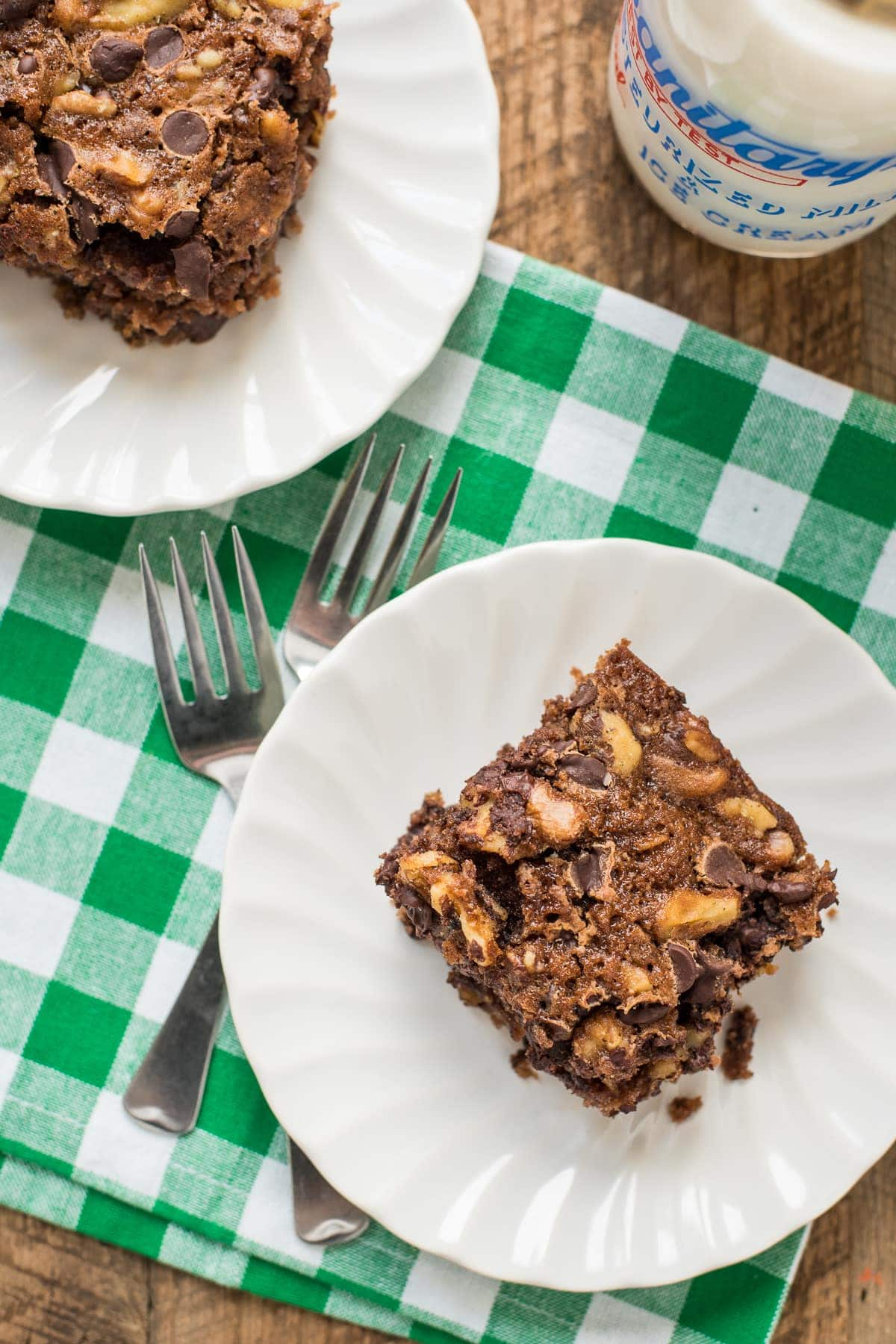 This Oatmeal Chocolate Chip Snack Cake has a hearty, chewy texture and is perfect as an after school snack!