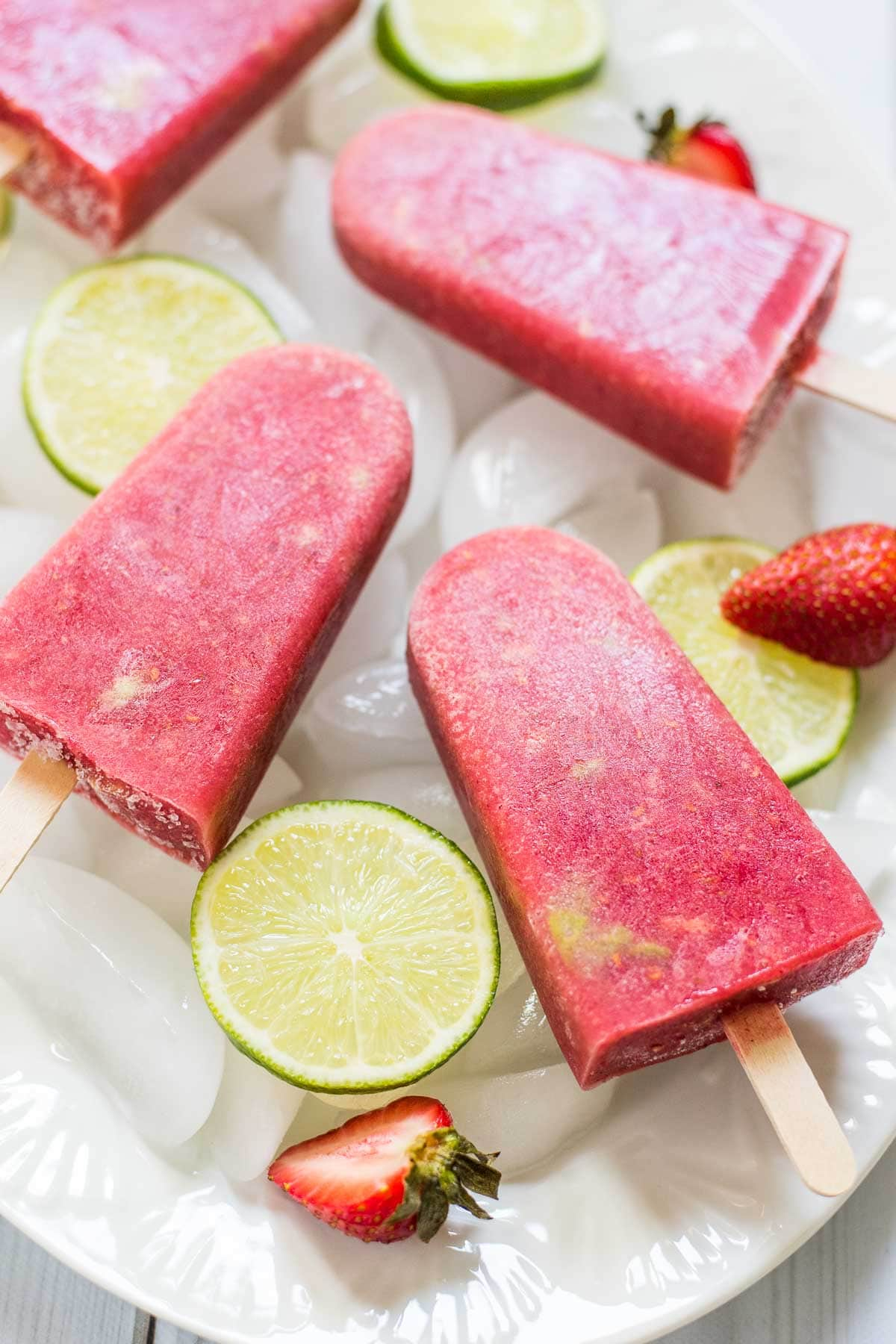 Berry Avocado Popsicles are packed with fresh berries, lime, and creamy avocado for an indulgent but healthy treat!