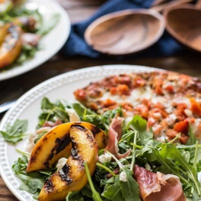 Juicy peaches, arugula, goat cheese, and prosciutto combine for the ultimate Grilled Peach Salad!