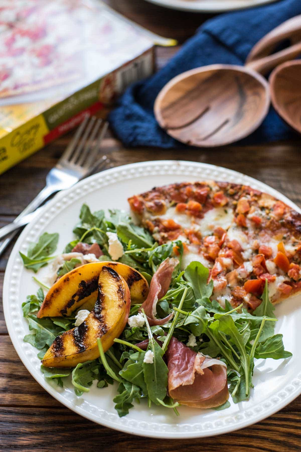 This Grilled Peach Arugula Salad is loaded with prosciutto and goat cheese for the ultimate summer salad.