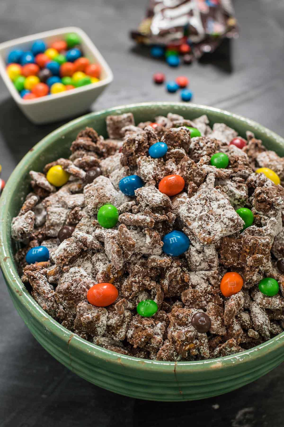 This easy no bake Chocolate Peanut Butter Puppy Chow is loaded with M&Ms pretzels and two kinds of cereal.