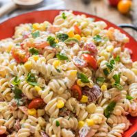 Packed with lime, cilantro, jalapeno, and fresh summer veggies this Southwest Pasta Salad is a hit at summer BBQs.