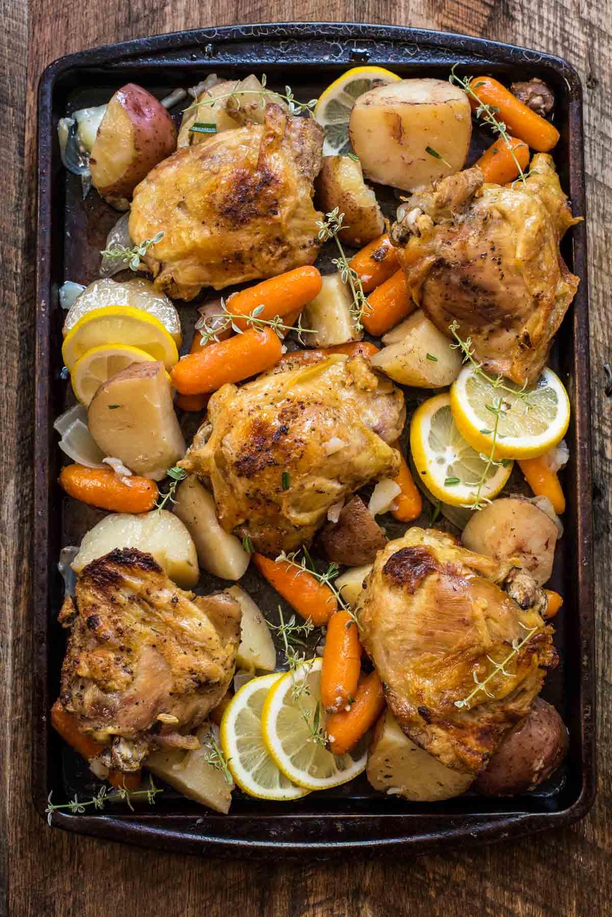 Crock Pot Lemon Garlic Chicken shown on a sheet pan