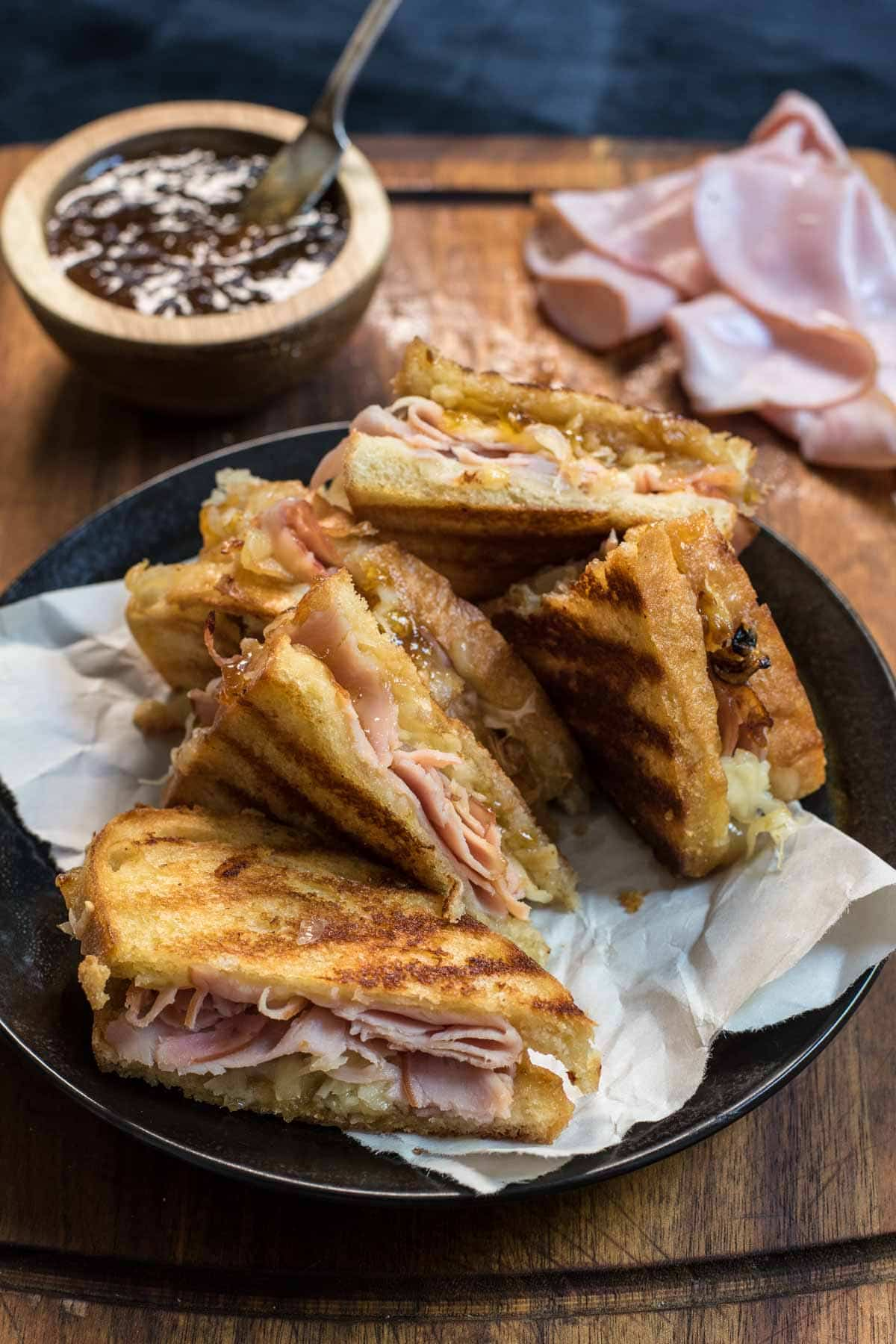 Class up grilled cheese night with this Gruyere Grilled Cheese with ham, caramelized onions, and fig jam.