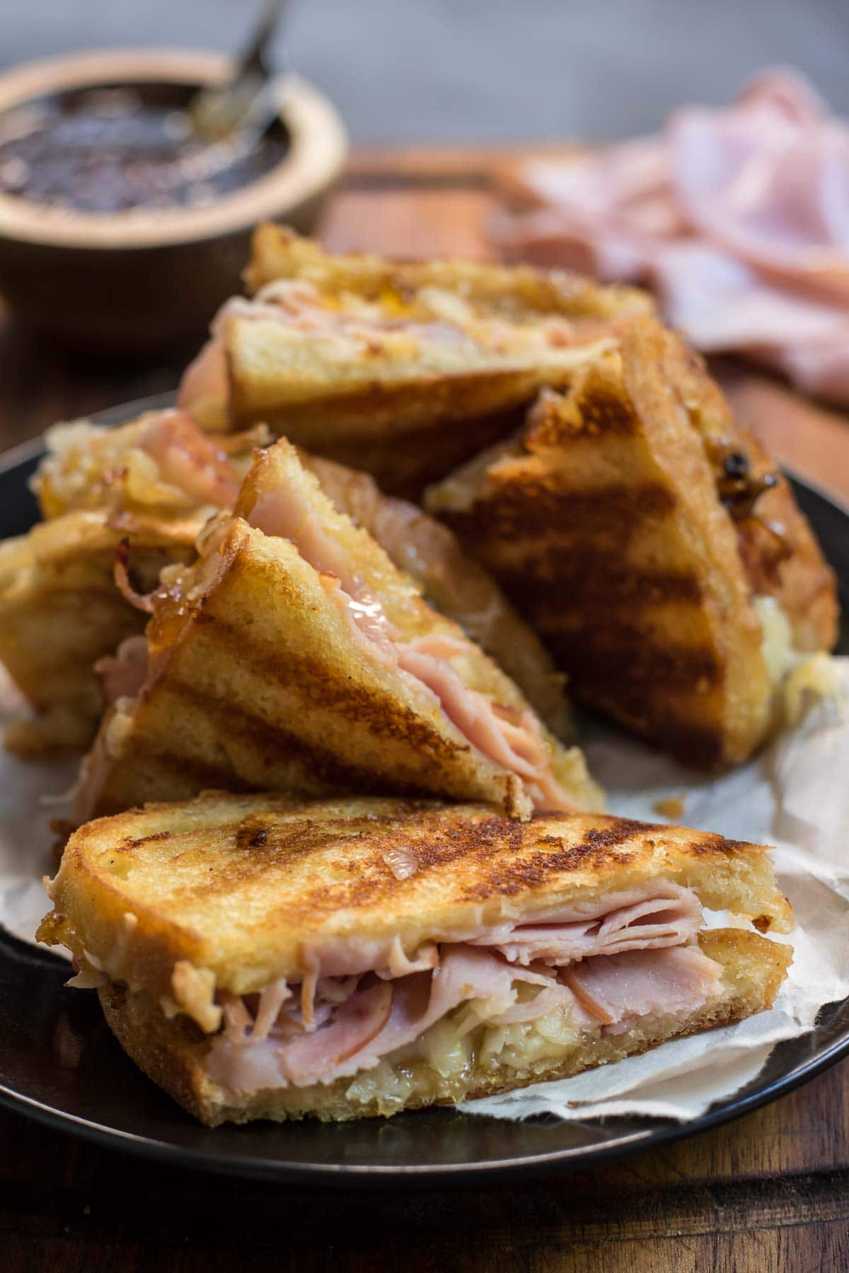 This sweet and savory Gruyere Grilled Cheese with Ham, Caramelized Onions, and Fig Jam is irresistible.