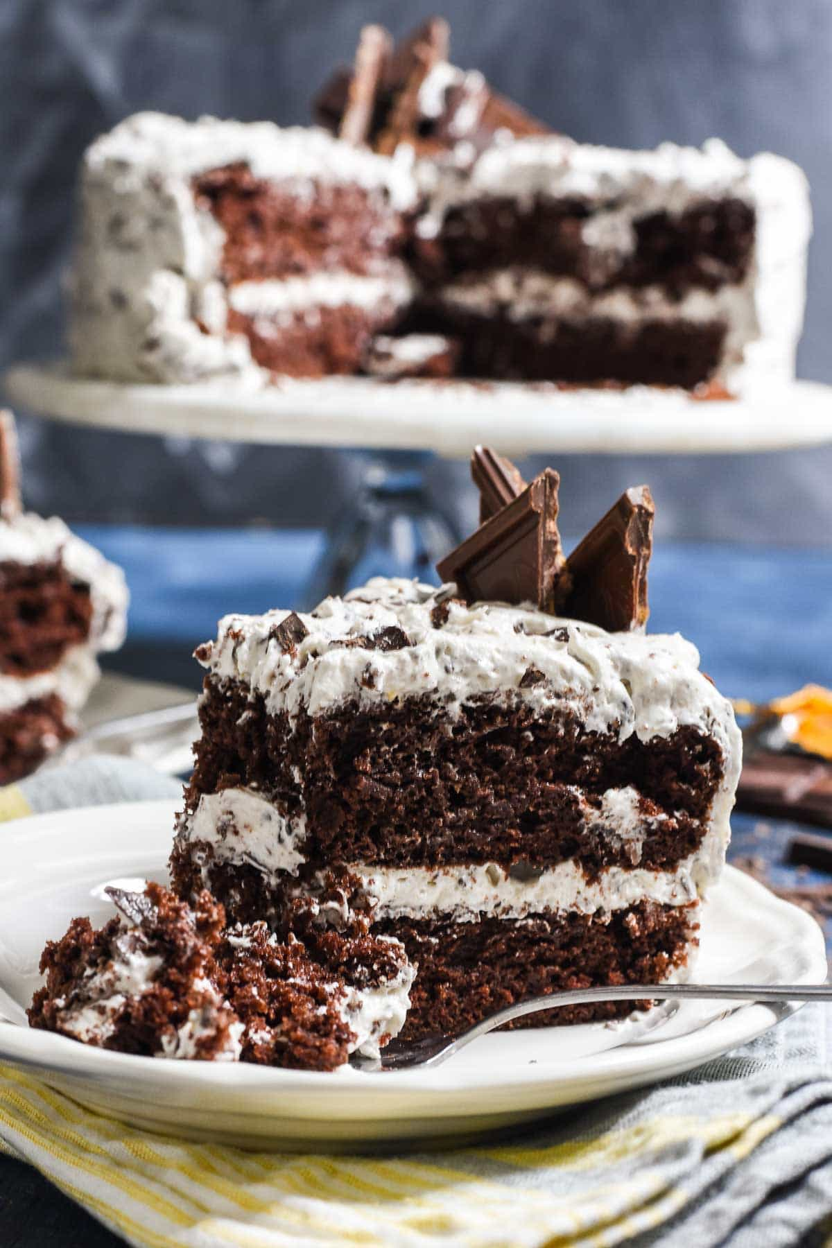 This Chocolate Candy Bar Cake starts with a fluffy chocolate cake layered with the fluffiest whipped frosting studded with your favorite candy bars!