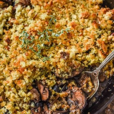 Baked Mushrooms soaked in red wine and butter and covered in parmesan bread crumbs--the ultimate mushroom lovers side dish!