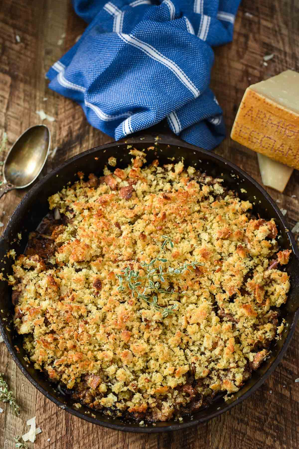 Wine soaked baked mushrooms sit under a layer of Parmesan bread crumbs for the ultimate mushroom lovers side dish.