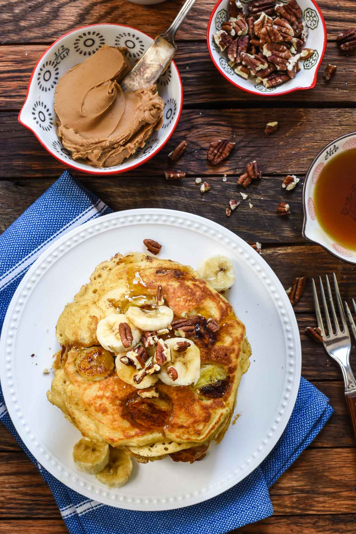Fluffy Banana Pancakes topped with toasted pecans and biscoff spread are perfect for the holidays or any day you want to treat yourself!