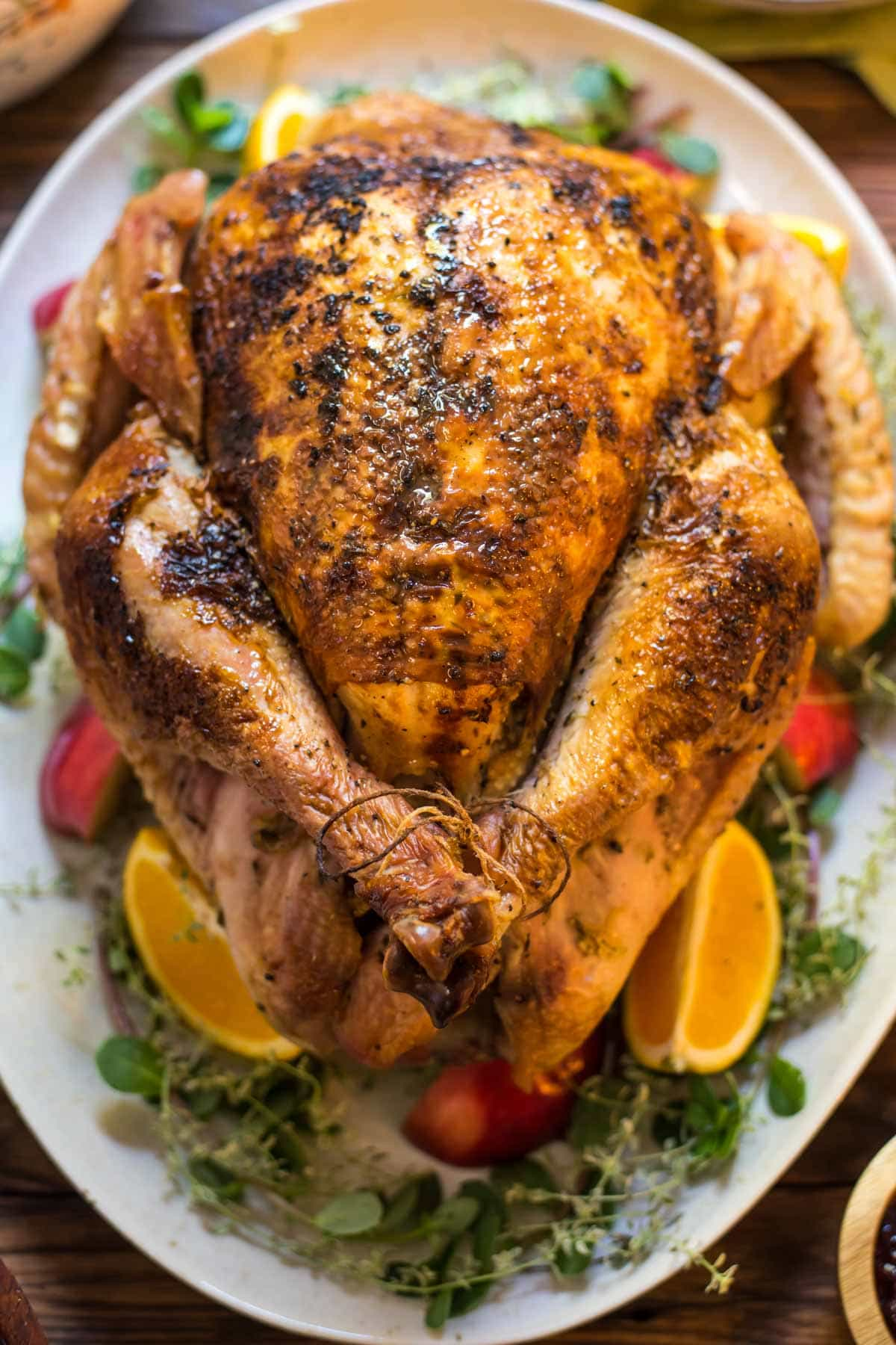 Citrus, herbs, butter and cider all come together to make this Braised Apple Cider Turkey juicy and tender!