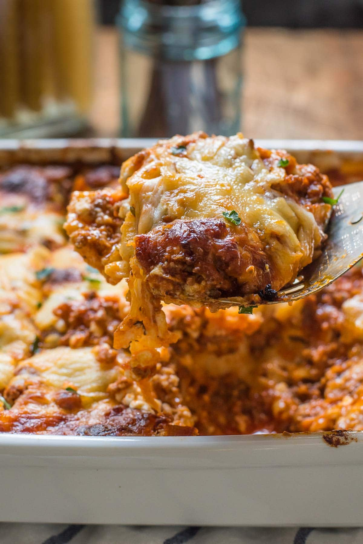 Simply the BEST Cottage Cheese Lasagna, loaded with meat, tomato sauce, and three cheeses!