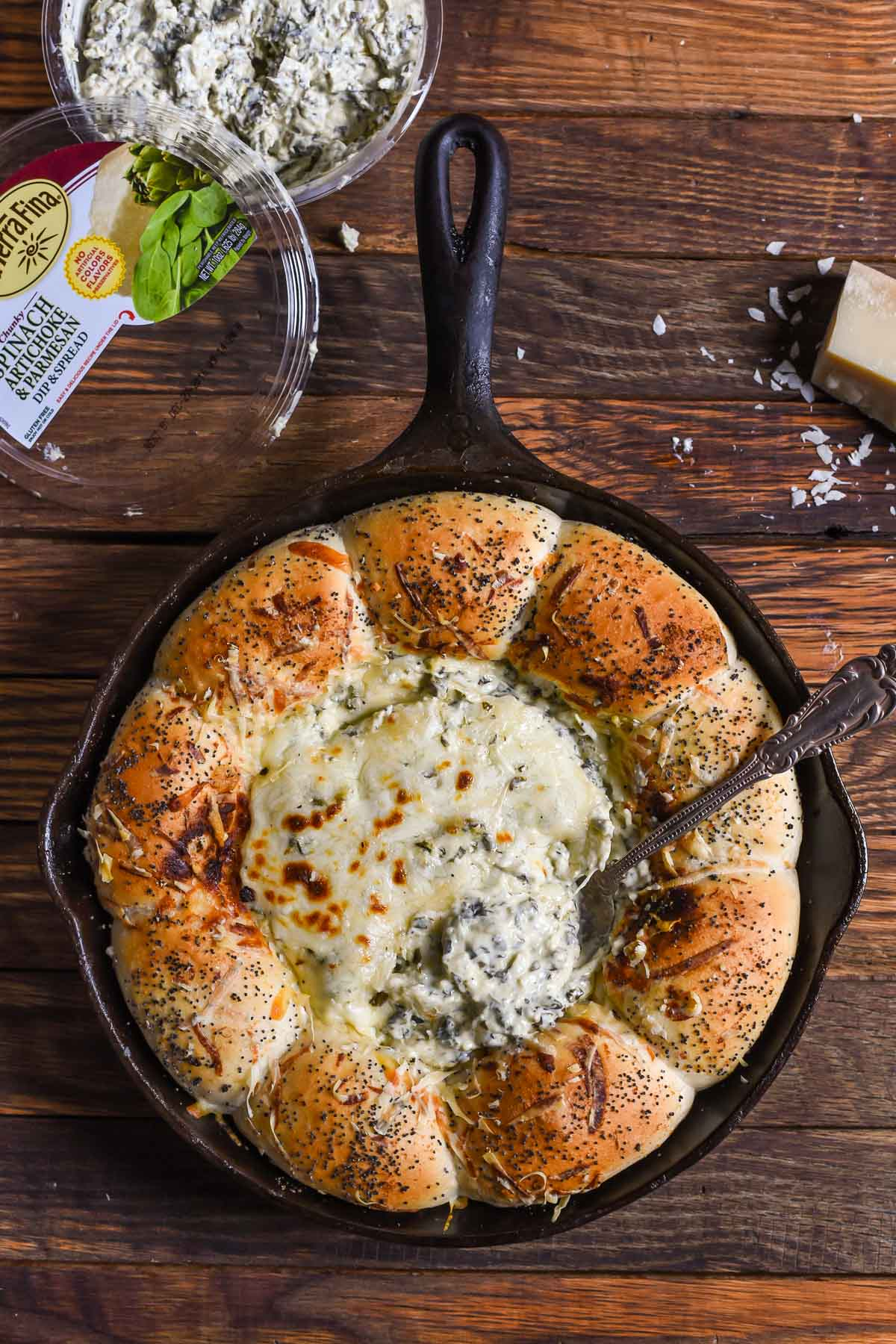 What could be better than fluffy bread and cheesy dip? This Skillet Bread and Spinach Artichoke Dip is so delicious and easy to make!