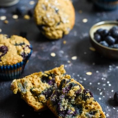 These Blueberry Oatmeal Muffins bursting with blueberries and made with Greek yogurt, coconut oil, and oats are a hearty, healthy way to start the day. They freeze great too!