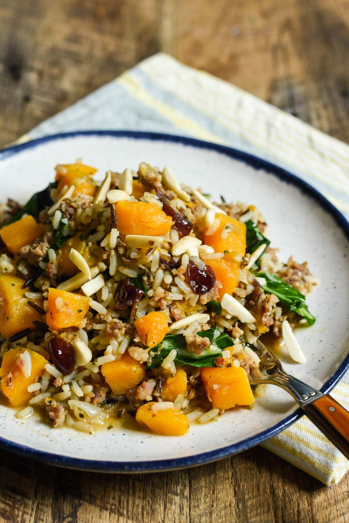 If you're looking for a quick, healthy one pot meal, try this Skillet Sausage and Rice with butternut squash, cranberries, and almonds!