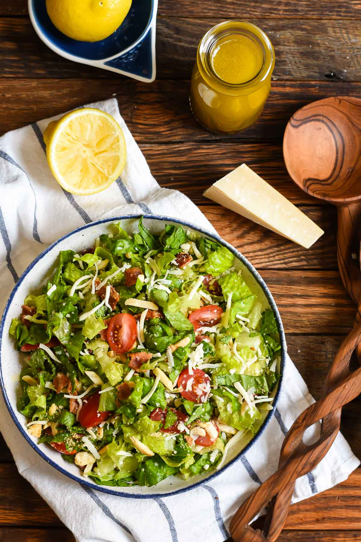 Known only as That GOOD Salad, this bowl has everything you need--crisp lettuce, tomatoes, crispy bacon, two cheeses, and croutons tossed in a simple lemon garlic dressing.