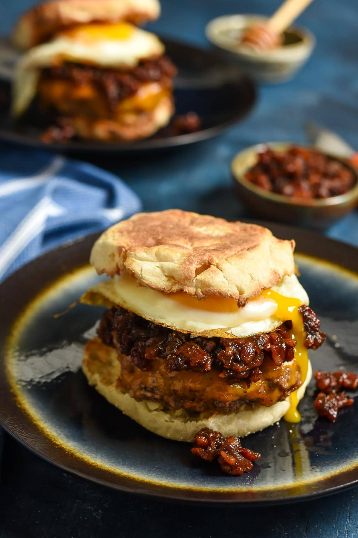 These Breakfast Burgers are smothered with cheese, a fried egg, and bourbon bacon jam for the ultimate breakfast sandwich.