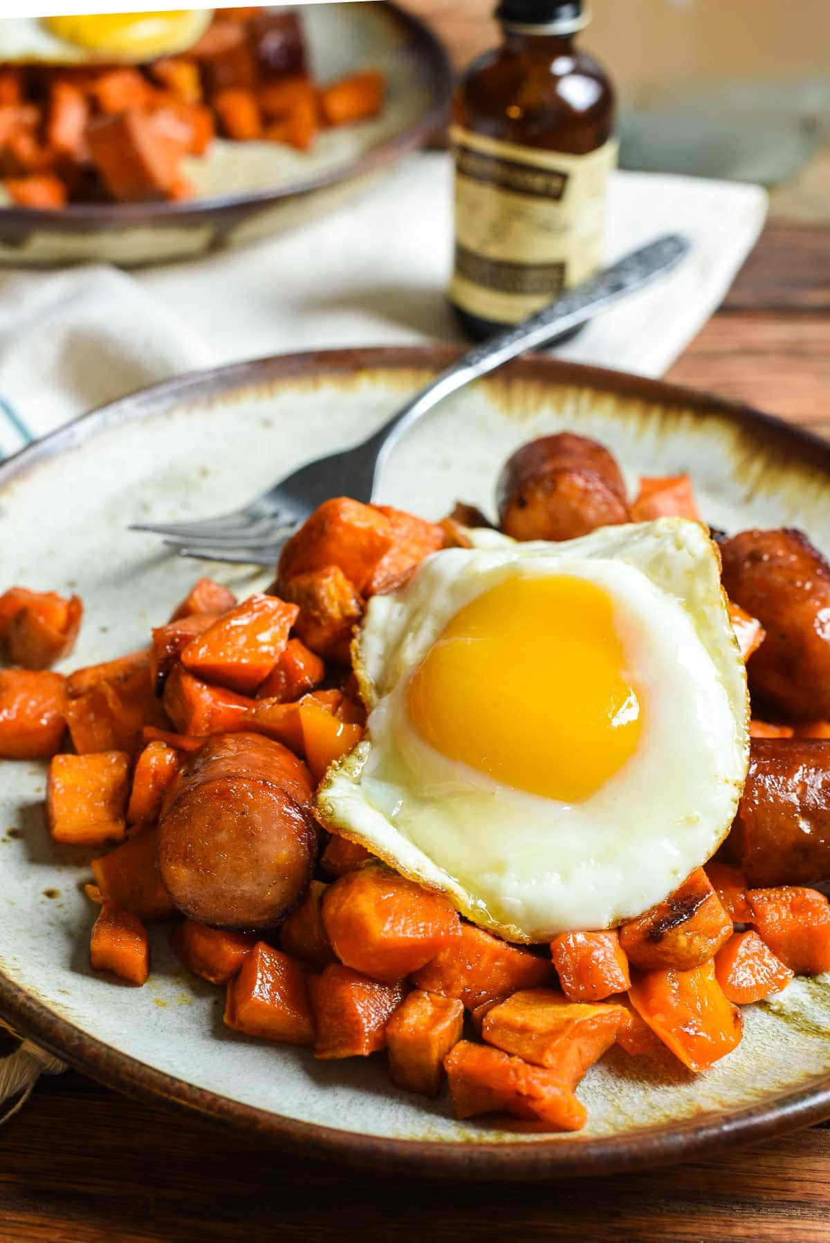 Maple Roasted Sweet Potato and Sausage Hash is perfect for a healthy breakfast or easy sheet pan dinner.