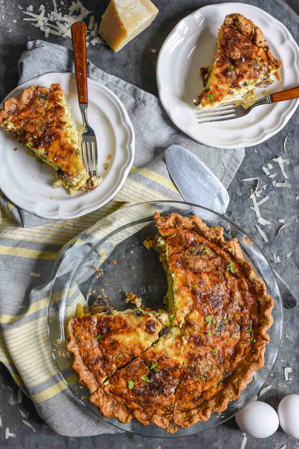 This Mushroom and Leek Quiche is loaded with cheesy gruyere for an indulgent spring brunch recipe!