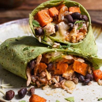 Sweet Potato Black Bean Burritos are loaded with protein, melty cheese, spicy black beans, and smoky maple sweet potatoes. The perfect freezer meal!