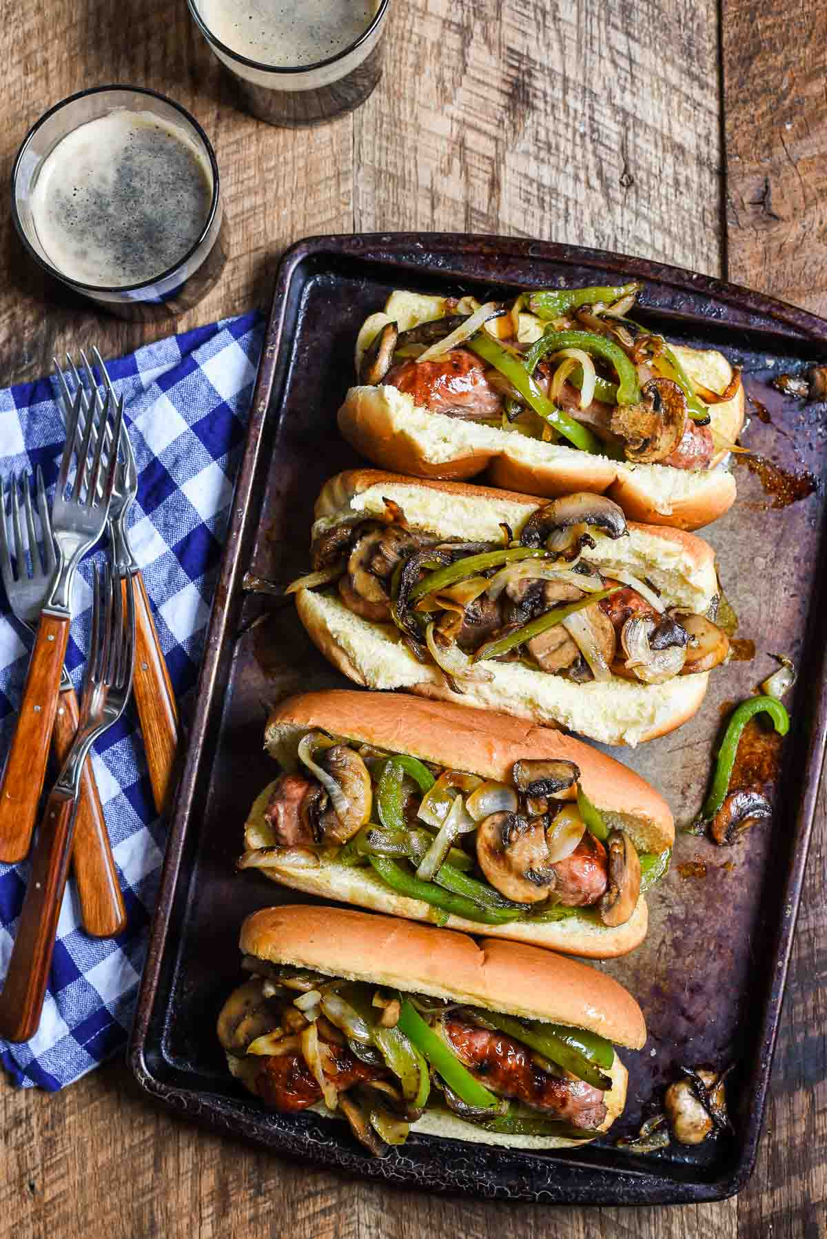 Philly Cheese Brats turn the classic philly into a great meal for the grill! This 30 minute meal will definitely be a hit at your summer cookouts!