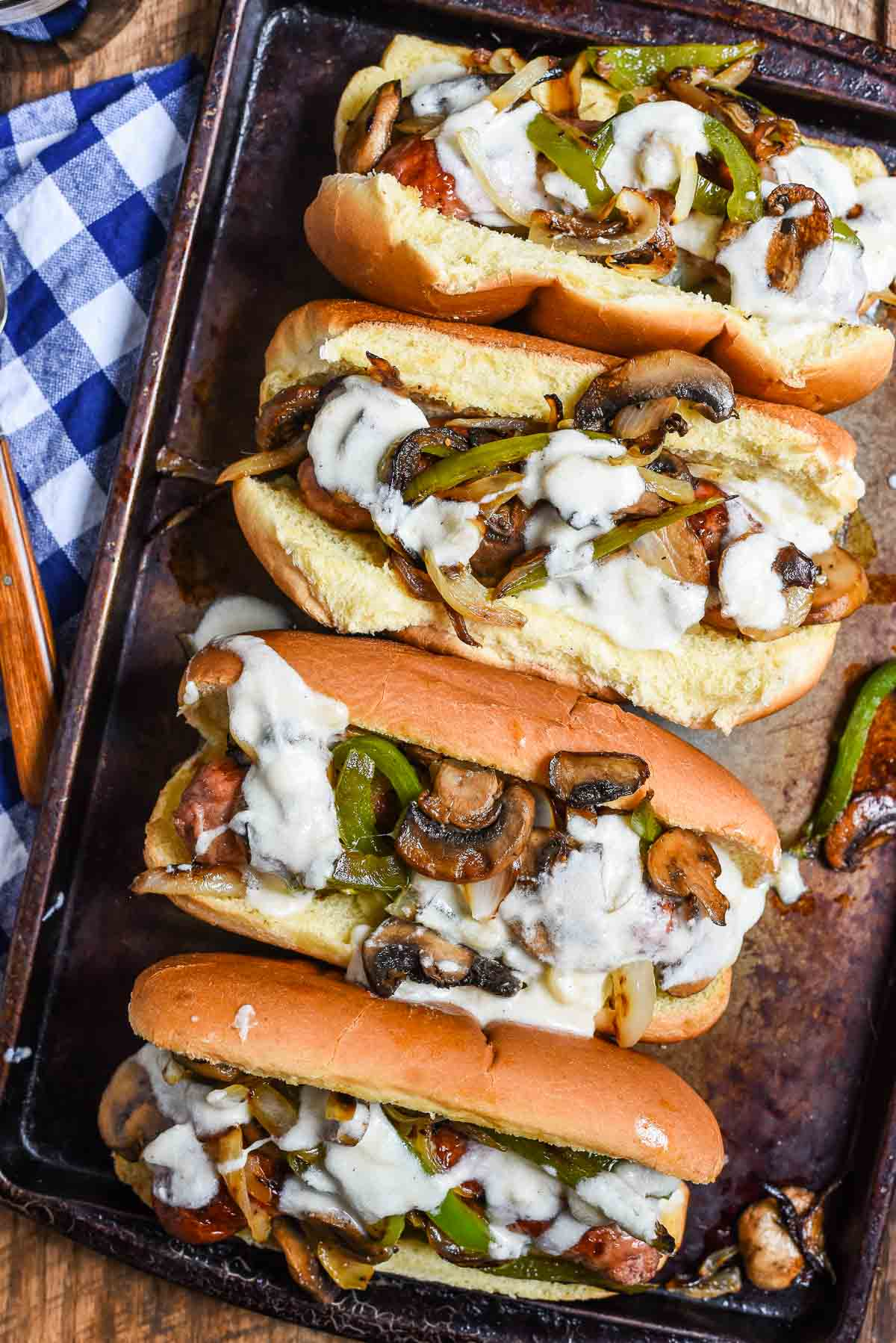 Philly Cheese Brats are a great 30 minute meal you can make almost entirely on the grill! Perfect for summer cookouts!