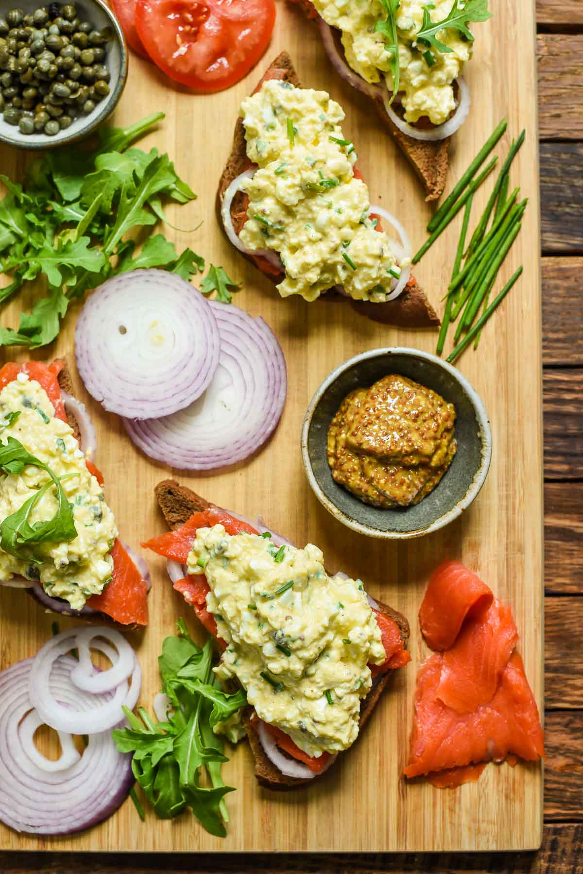 Smoked Salmon Egg Salad Sandwiches take traditional egg salad up a notch! Topped with capers and red onions, this recipe is great for spring brunches or showers!