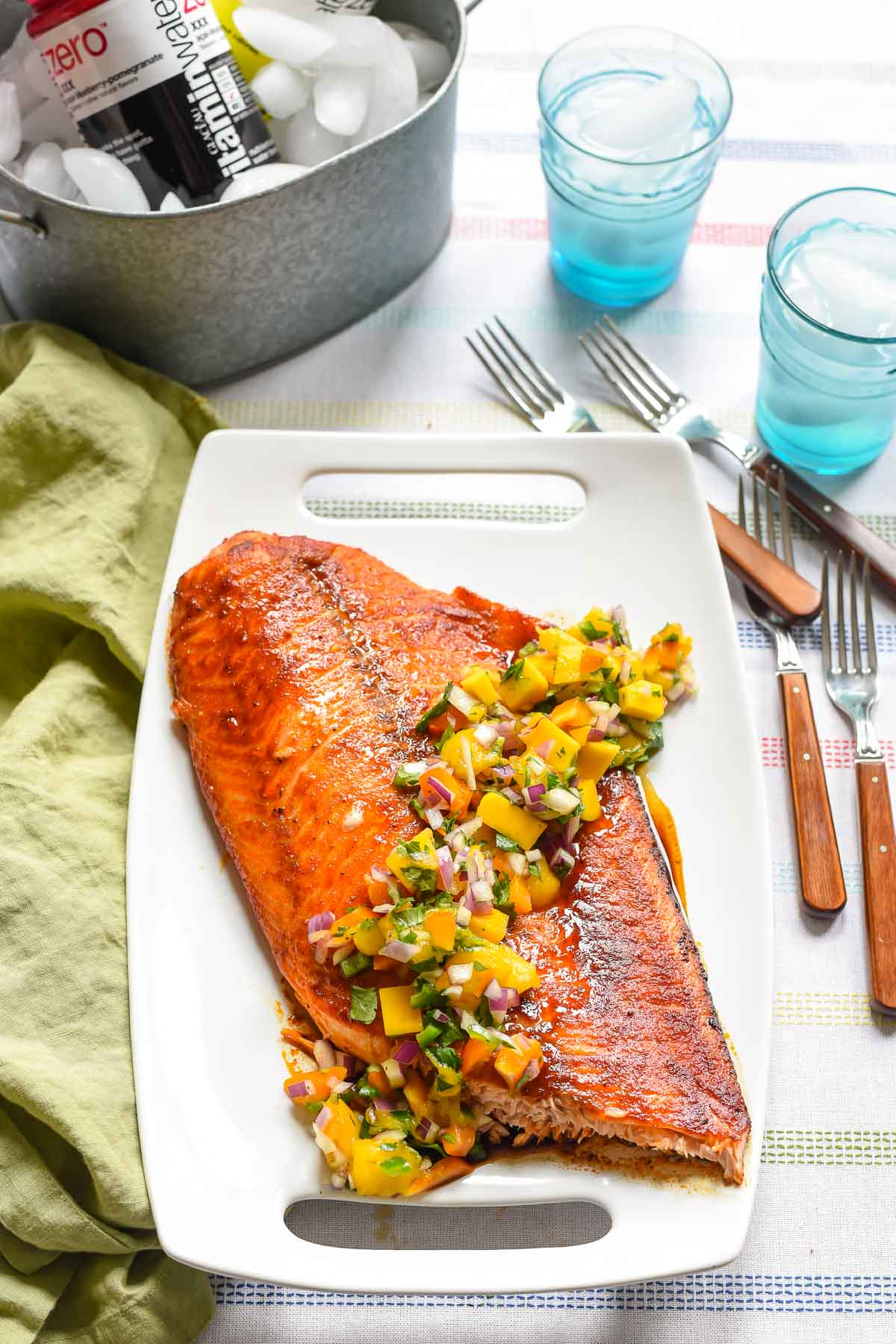Grilled Salmon with Mango Salsa is a light, refreshing summer meal that's super easy to make and perfect for serving a crowd!