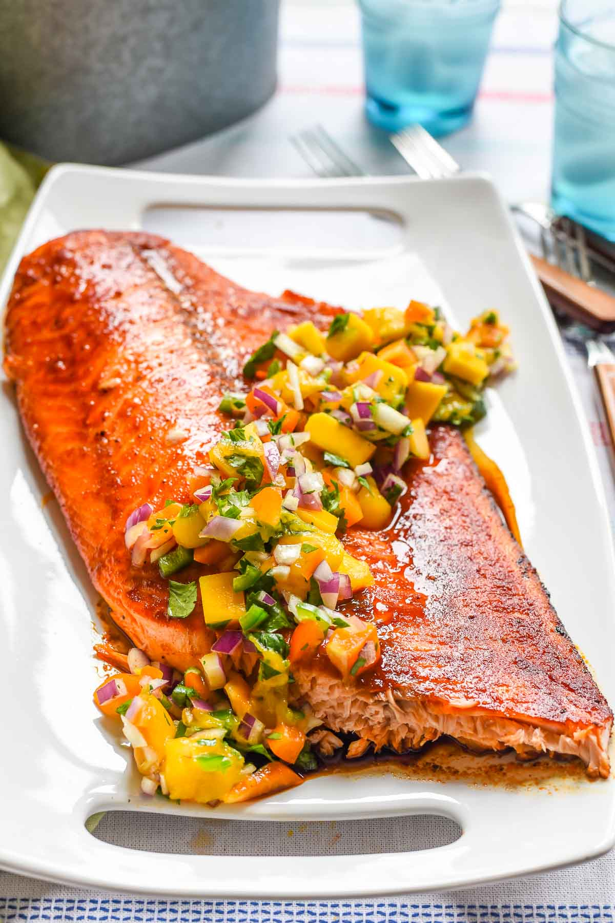 Grilled Salmon with Mango Salsa is a fresh, healthy meal loaded with flavor. This dinner is perfect for summer BBQs!