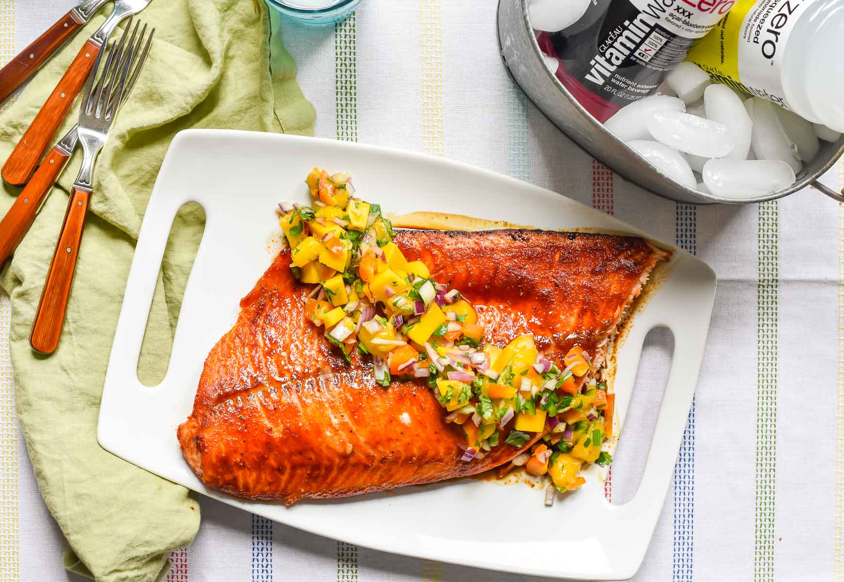 Grilled Salmon with Mango Salsa uses a foil packet to keep the salmon moist and tender!