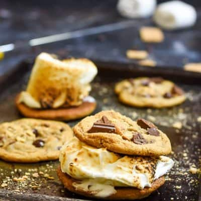 Graham Cracker Chocolate Chip Cookies sandwiched around a toasted marshmallow is all you need for a perfect camping dessert.