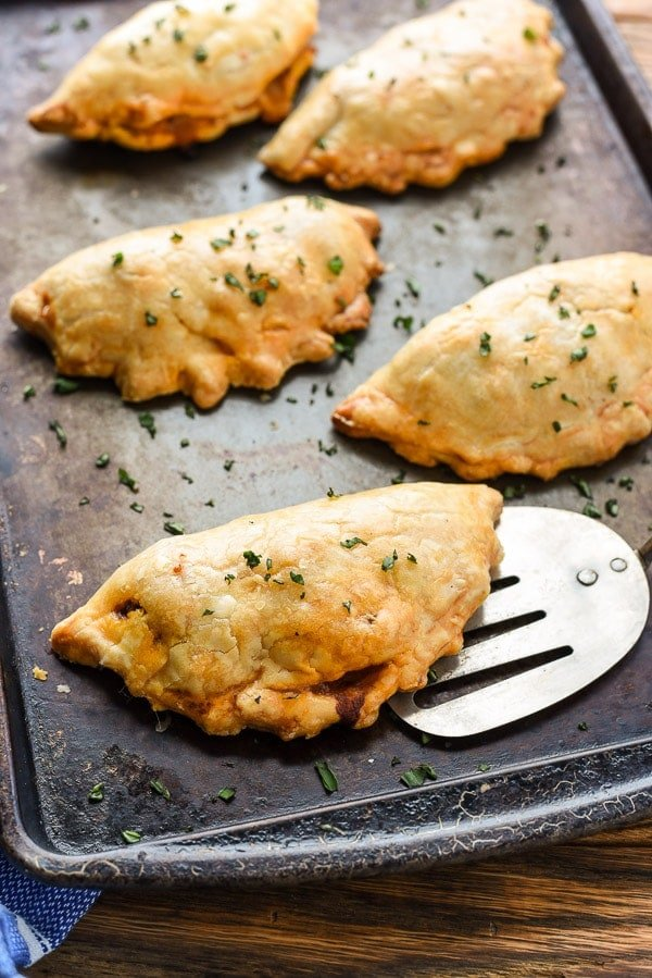 Ground Beef Empanadas are loaded with veggies, meat, and cheese and wrapped in flaky pie crust for a delectable hand held meal!