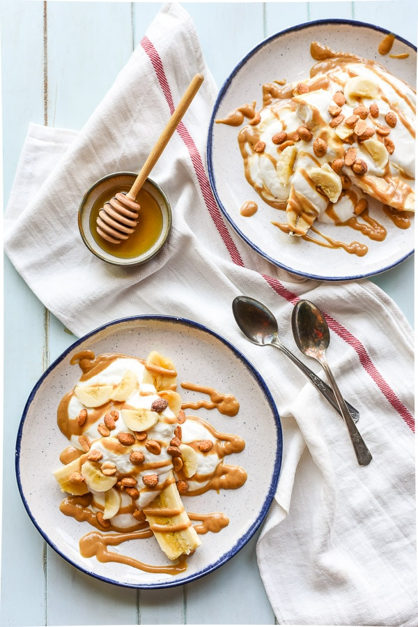 Honey and peanut butter are swirled into yogurt to make these awesome Peanut Butter Breakfast Banana Splits!