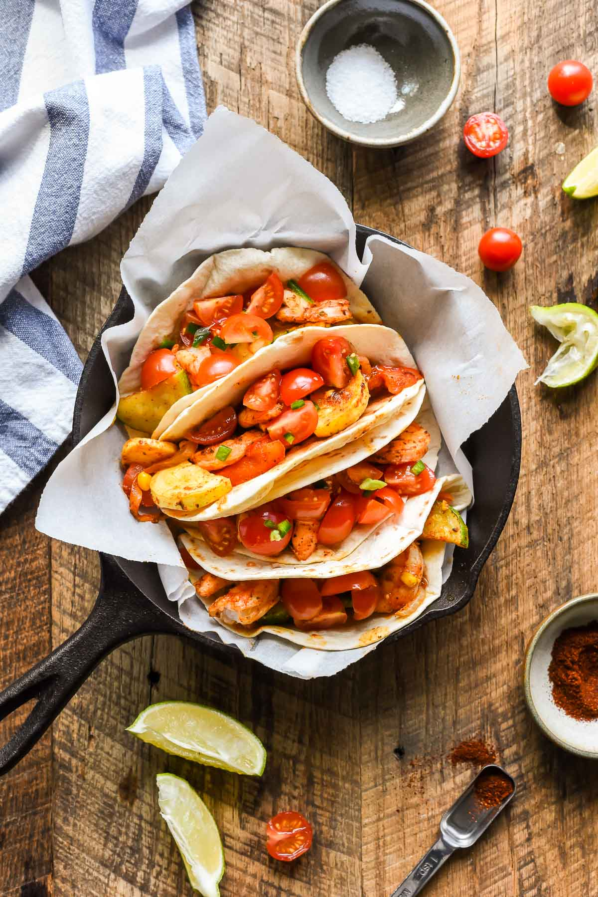These Sheet Pan Shrimp Tacos loaded with summer veggies are a great 30 minute meal.