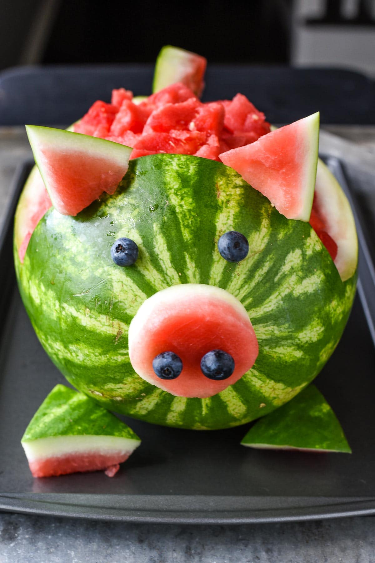 This Watermelon Pig is way easier to make than it looks and is awesome for a farm themed birthday party!