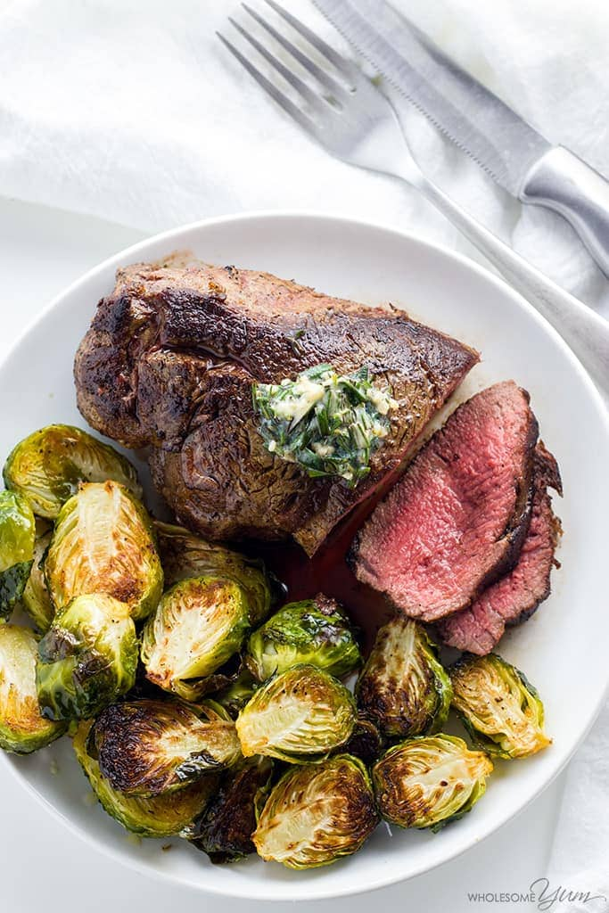 steak recipe on a plate with brussels sprouts
